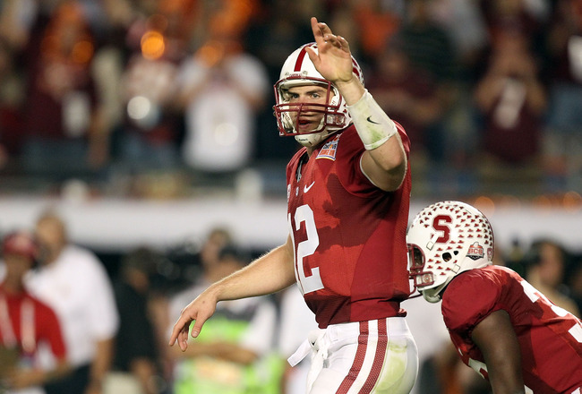MIAMI, FL - JANUARY 03: Quarterback Andrew Luck #12 of the Stanford Cardinal gestures as he calls out signals on offense against the Virginia Tech Hokies during the 2011 Discover Orange Bowl at Sun Life Stadium on January 3, 2011 in Miami, Florida. Stanfo