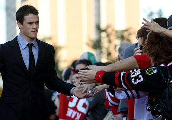 CHICAGO - OCTOBER 09: Jonathan Toews of the Chicago Blackhawks greets fans as he walks down a red carpet before the Blackhawks season home opening game against the Detroit Red Wings at the United Center on October 9, 2010 in Chicago, Illinois. (Photo by J