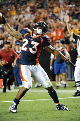 DENVER, CO - AUGUST 27: Willis McGahee #23 of the Denver Broncos celebrates his touchdown during the preseason game against the Seattle Seahawks at Sports Authority Field at Mile High on August 27, 2011 in Denver, Colorado.  (Photo by Garrett W. Ellwood/G