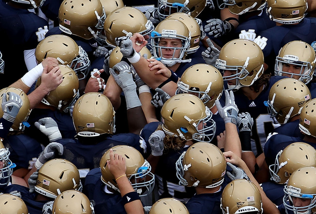 SOUTH BEND, IN - SEPTEMBER 25: Members of the Notre Dame Fighting Irish get ready during warm-ups to play the Stanford Cardinal at Notre Dame Stadium on September 25, 2010 in South Bend, Indiana. Stanford defeated Notre Dame 37-14. (Photo by Jonathan Dani