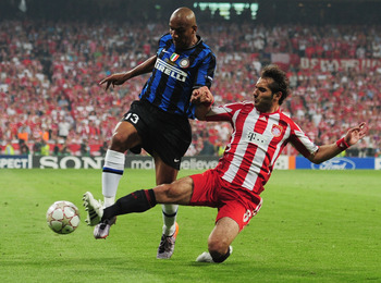 MADRID, SPAIN - MAY 22: Maicon of Inter Milan is challenged by Hamit Altintop of Bayern Muenchen during the UEFA Champions League Final match between FC Bayern Muenchen and Inter Milan at the Estadio Santiago Bernabeu on May 22, 2010 in Madrid, Spain.  (P