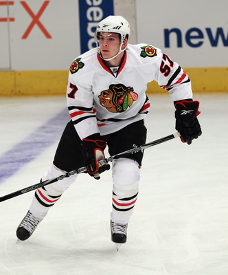 NEW YORK - NOVEMBER 01:  Ben Smith #57 of the Chicago Blackhawks skates against the New York Rangers at Madison Square Garden on November 1, 2010 in New York City. The Rangers defeated the Blackhawks 3-2.  (Photo by Bruce Bennett/Getty Images)