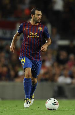 BARCELONA, SPAIN - AUGUST 29:  Javier Mascherano of FC Barcelona runs with the ball during the La Liga match between FC Barcelona and Villarreal CF at Camp Nou on August 29, 2011 in Barcelona, Spain.  (Photo by David Ramos/Getty Images)