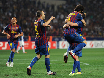MONACO - AUGUST 26:  Cesc Fabregas (2nd R) of FC Barcelona celebrates scoring his sides second goal with his teammates Lionel Messi (R) and Andres Iniesta during the UEFA Super Cup match between FC Barcelona and FC Porto at Louis II Stadium on August 26,