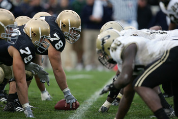 SOUTH BEND, IN - SEPTEMBER 30: Center John Sullivan #78 of the Notre Dame Fighting Irish readies to snap the ball against the Purdue Boilermakers September 30, 2006 at Notre Dame Stadium in South Bend, Indiana. Notre Dame won 35-21. (Photo by Jonathan Dan