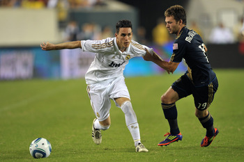 PHILADELPHIA, PA - JULY 23: Jack McInerney #19 of the Philadelphia Union holds onto an attacking Jose Maria Callejo #21 of Real Madrid at Lincoln Financial Field on July 23, 2011 in Philadelphia, Pennsylvania. Real Madrid won 2-1. (Photo by Drew Hallowell