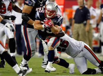 TAMPA, FL - AUGUST 18:  Running back Danny Woodhead #39 of the New England Patriots runs the ball as safety Sean Jones #26 of the Tampa Bay Buccaneers makes the tackle during a preseason game at Raymond James Stadium on August 18, 2011 in Tampa, Florida.
