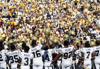 CHAPEL HILL, NC - SEPTEMBER 18:  The Georgia Tech Yellow Jackets celebrate with fans after defeating the North Carolina Tar Heels during their game at Kenan Stadium on September 18, 2010 in Chapel Hill, North Carolina.  (Photo by Streeter Lecka/Getty Imag