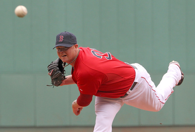 BOSTON, MA - AUGUST 27:  Jon Lester #31 of the Boston Red Sox throws against the Oakland Athletics at Fenway Park August 27, 2011 in Boston, Massachusetts. (Photo by Jim Rogash/Getty Images)