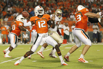 MIAMI, FL - OCTOBER 9: Jacory Harris #12 of the Miami Hurricanes hrows the ball against the Florida State Seminoles on October 9, 2010 at Sun Life Stadium in Miami, Florida. (Photo by Joel Auerbach/Getty Images)