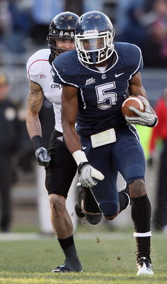 EAST HARTFORD, CT - NOVEMBER 27:  Blidi Wreh-Wilson#5 of the Connecticut Huskies avoids the Cincinnati Bearcats after he intercepted a pass in the fourth quarter on November 27, 2010 at Rentschler Field in East Hartford, Connecticut. The Huskies defeated