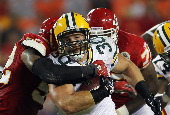 KANSAS CITY, MO - SEPTEMBER 02:  Fullback John Kuhn #30 of the Green Bay Packers carries the ball during the game against the Kansas City Chiefs on September 2, 2010 at Arrowhead Stadium in Kansas City, Missouri.  (Photo by Jamie Squire/Getty Images)