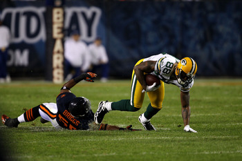 CHICAGO - SEPTEMBER 27:  Jermichael Finley #88 of the Green Bay Packers makes a reception against Lance Briggs #55 of the Chicago Bears at Soldier Field on September 27, 2010 in Chicago, Illinois. The Bears won 20-17.  (Photo by Jonathan Daniel/Getty Imag