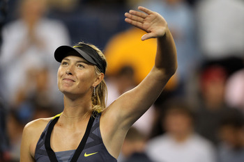 Sharapova smiles after a crushing 6-1, 6-1 defeat of Yakimova in the second round