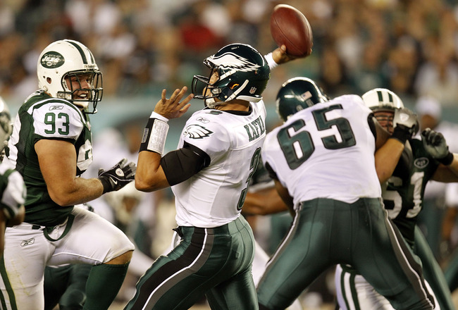 PHILADELPHIA - SEPTEMBER 02:  Mike Kafka #3 of the Philadelphia Eagles passes under pressure from Matt Kroul #93 of the New York Jets during a preseason game at Lincoln Financial Field on September 2, 2010 in Philadelphia, Pennsylvania.  (Photo by Jeff Ze