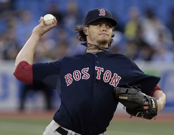 Clay Buchholz is on the DL with a stress fracture in his back.