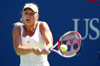 Wozniacki strikes a backhand at the 2011 US Open, winning her first round match convincingly