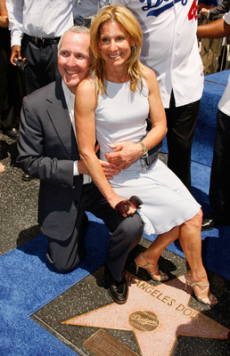 HOLLYWOOD - JUNE 20:  Team owner Frank McCourt (L) and wife Jamie attend a special star ceremony honoring the Los Angeles Dodgers with an Award of Excellence on the Hollywood Walk of Fame on June 20, 2008 in Hollywood, California.  (Photo by Vince Bucci/G