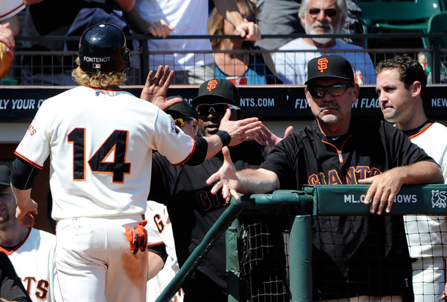 SAN FRANCISCO, CA - AUGUST 31:  Mike Fontenot #14 of the San Francisco Giants celebrates with manager Bruce Bochy after scoring on a double by Chris Stewart against the Chicago Cubs in the six inning during an MLB baseball game at AT&T Park on August 31,