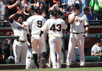 SAN FRANCISCO, CA - AUGUST 28: Matt Cain #18 and Pablo Sandoval #48 of the San Francisco Giants congratulate Brandon Belt #9 who scored on a sacrifice fly ball by Orlando Cabrera #43 in the bottom of the seventh inning giving them a 2-1 lead over the Hous
