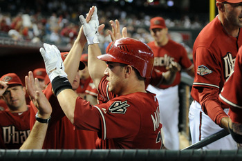PHOENIX, AZ - AUGUST 31:  Miguel Montero #26 of the Arizona Diamondbacks celebrates a home run with teammates in the dugout against the Colorado Rockies at Chase Field on August 31, 2011 in Phoenix, Arizona.  (Photo by Norm Hall/Getty Images)