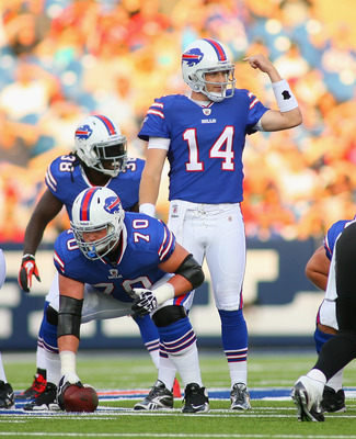 ORCHARD PARK, NY - AUGUST 27:Ryan Fitzpatrick #14 of the Buffalo Bills calls signals behind Eric Wood #70 against the Jacksonville Jaguars  at Ralph Wilson Stadium on August 27, 2011 in Orchard Park, New York.  (Photo by Rick Stewart/Getty Images)