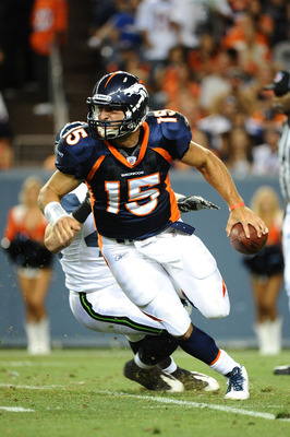 DENVER, CO - AUGUST 27: Tim Tebow #15 of the Denver Broncos runs with the ball during the pre season game against the Seattle Seahawks at Sports Authority Field at Mile High on August 27, 2011 in Denver, Colorado.  (Photo by Garrett W. Ellwood/Getty Image