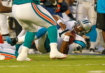 MIAMI GARDENS, FL - AUGUST 19:  Cam Newton #1 of the Carolina Panthers is tackled during a preseason NFL game against the Miami Dolphins at Sun Life Stadium on August 19, 2011 in Miami Gardens, Florida.  (Photo by Mike Ehrmann/Getty Images)
