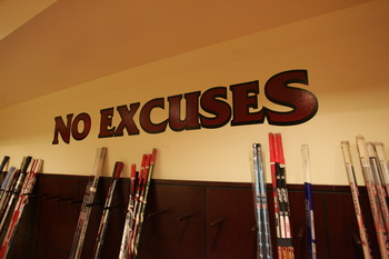GLENDALE, AZ - MARCH 5:  Hockey sticks rest against the wall with the words 'No Excuses' at the Wayne Gretzky Fantasy Camp V held on March 5, 2007 in Glendale, Arizona.  (Photo by Bruce Bennett/Getty Images for WDG)