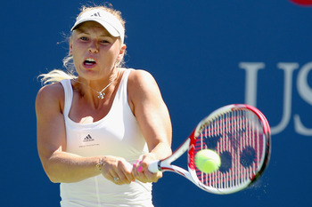 NEW YORK, NY - AUGUST 30:  Caroline Wozniacki of Denmark returns a shot against Nuria Llagostera Vives of Spain during Day Two of the 2011 US Open at the USTA Billie Jean King National Tennis Center on August 30, 2011 in the Flushing neighborhood of the Q
