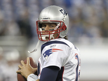 DETROIT - AUGUST 27:  Quarterback Tom Brady #12 of the New England Patriots warms up prior to the start of the pre-season game against the Detroit Lions at Ford Field on August 27, 2011 in Detroit, Michigan.  (Photo by Leon Halip/Getty Images)