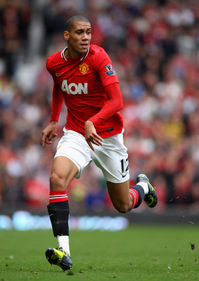 MANCHESTER, ENGLAND - AUGUST 28:  Chris Smalling of Manchester United in action during the Barclays Premier League match between Manchester United and Arsenal at Old Trafford on August 28, 2011 in Manchester, England.  (Photo by Alex Livesey/Getty Images)