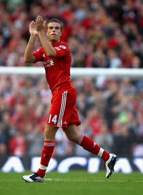 LIVERPOOL, ENGLAND - AUGUST 27:  Jordan Henderson of Liverpool appaulds the crowds as he is substituted during the Barclays Premier League match between Liverpool and Bolton Wanderers at Anfield on August 27, 2011 in Liverpool, England.  (Photo by Clive B