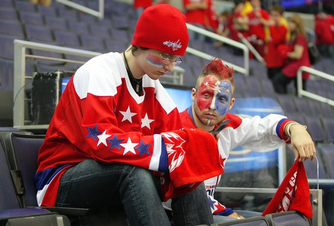 WASHINGTON - APRIL 22:  Two disappointed fans of the Washington Capitals sit dejected after the overtime loss against the Philadelphia Flyers during game seven of the Eastern Conference Quarterfinals of the 2008 NHL Stanley Cup Playoffs on April 22, 2008