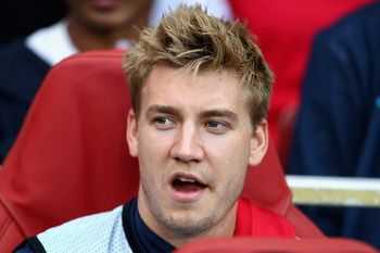 LONDON, ENGLAND - AUGUST 16:  Nicklas Bendtner of Arsenal looks on from the bench ahead of the UEFA Champions League play-off first leg match between Arsenal and Udinese at the Emirates Stadium on August 16, 2011 in London, England.  (Photo by Julian Finn