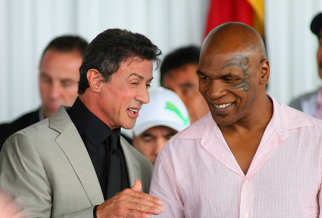 CANASTOTA, NY - JUNE 12: Sylvester Stallone and Mike Tyson speak prior to the 2011 International Boxing Hall of Fame Inductions at the International Boxing Hall of Fame on June 12, 2011 in Canastota, New York. Both Stallone and Tyson were 2011 Inductees.