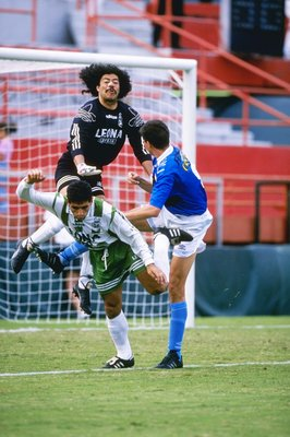 26 Jan 1997:  Rene Higuita and Adrian Czorndmar fight for the ball during a Copa Cup game between Cristal and Nacional at the Orange Bowl in Miami, Florida.  Cristal won the game 2-0. Mandatory Credit: Andy Lyons  /Allsport