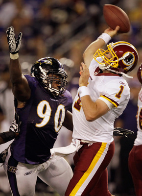 BALTIMORE, MD - AUGUST 25: Quarterback Kellen Clemens #1 of the Washington Redskins gets off a pass while being pressured by Pernell McPhee #90 of the Baltimore Ravens during the second half of a preseason game at M&T Bank Stadium on August 25, 2011 in Ba