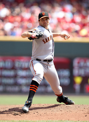 CINCINNATI, OH - JULY 31:  Barry Zito #75 of the San Francisco Giants throws a pitch during the game against the Cincinnati Reds at Great American Ball Park on July 31, 2011 in Cincinnati, Ohio.  (Photo by Andy Lyons/Getty Images)