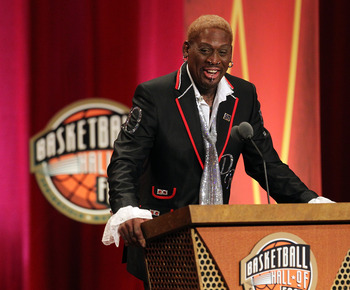 SPRINGFIELD, MA - AUGUST 12:   Dennis Rodman gestures during the Basketball Hall of Fame Enshrinement Ceremony at Symphony Hall on August 12, 2011 in Springfield, Massachusetts. (Photo by Jim Rogash/Getty Images)