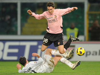 PALERMO, ITALY - FEBRUARY 02: Matteo Darmian (Top) of Palermo jumps as Zdenek Grygera of Juventus tackles during the Serie A match between US Citta di Palermo and Juventus FC at Stadio Renzo Barbera on February 2, 2011 in Palermo, Italy.  (Photo by Tullio