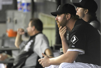 CHICAGO, IL - AUGUST 29:  Adam Dunn #32 of the Chicago White Sox sits in the dugout during the ninth inning against the Minnesota Twins at U.S. Cellular Field on August 29, 2011 in Chicago, Illinois.  (Photo by Brian Kersey/Getty Images)