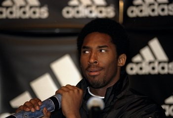 Aug 1998:  Kobe Bryant with a Didgeridoo at a press conference during an Adidas promotional tour of Sydney, Australia. \  NOTE TO USER: It is expressly understood that the only rights Allsport are offering to license in this Photograph are one-time, non-e