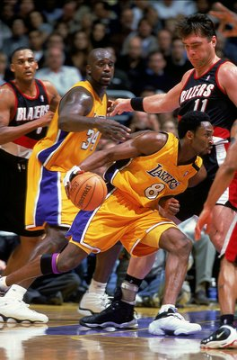 3 Dec 1999: Kobe Bryant #8 of the Los Angeles Lakers dribbles the ball to the basket during a game against the Portland TrailBlazers at the Staples Center in Los Angeles, California. The Lakers defeated the Blazers 93-80.  Mandatory Credit: Tom Hauck  /Al