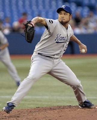 TORONTO, CANADA - AUGUST 23: Bruce Chen #52 of the Kansas City Royals throws a pitch against the Toronto Blue Jays during MLB action at Rogers Centre August 23, 2011 in Toronto, Ontario, Canada. (Photo by Abelimages/Getty Images)
