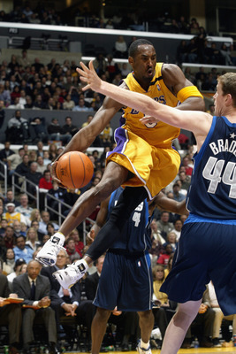 LOS ANGELES  - DECEMBER 6:   Kobe Bryant #8 of the Los Angeles Lakers looks to pass around Sean Bradley #44 of the Dallas Mavericks during the NBA game at the Staples Center on December 6, 2002 in Los Angeles, California.  The Lakers came back from a 30-p