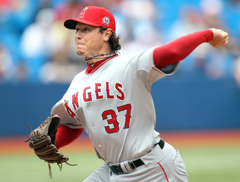 TORONTO, CANADA - AUGUST 14:  Scott Downs #37 of the Los Angeles Angels of Anaheim pitches in a MLB game against the Toronto Blue Jays on August 14, 2011 at the Rogers Centre in Toronto, Canada. The Jays defeated the Angels 5-4 in extra innings. (Photo by