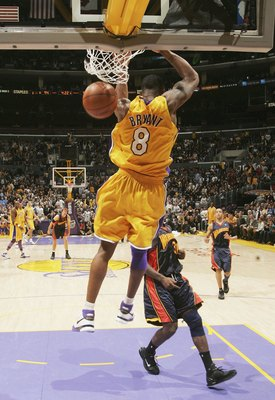 LOS ANGELES - JANUARY 27:  Kobe Bryant #8 of the Los Angeles Lakers makes a reverse layup against the Golden State Warriors on January 27, 2006 at Staples Center in Los Angeles, California. The Lakers won 106-105 in overtime. NOTE TO USER: User expressly
