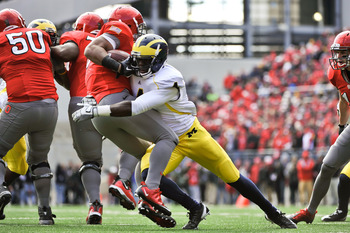 COLUMBUS, OH - NOVEMBER 27:  Cameron Gordon #4 of the Michigan Wolverines tackles Brandon Saine #3 of the Ohio State Buckeyes at Ohio Stadium on November 27, 2010 in Columbus, Ohio.  (Photo by Jamie Sabau/Getty Images)