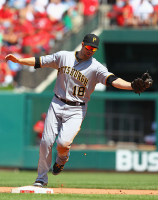 ST. LOUIS, MO - AUGUST 28: Neil Walker #18 of the Pittsburgh Pirates records the third out at second base against the St. Louis Cardinals at Busch Stadium on August 28, 2011 in St. Louis, Missouri.  The Cardinals beat the Pirates 7-4.  (Photo by Dilip Vis